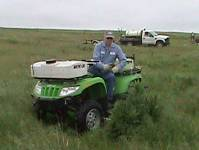 Man on a herbicide distributor